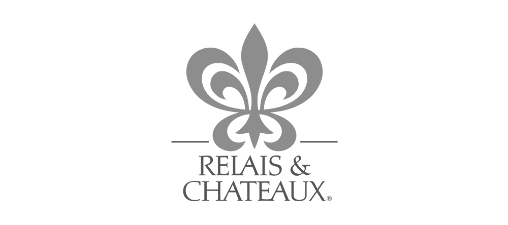 Greyscale Relais and Chateaux logo.